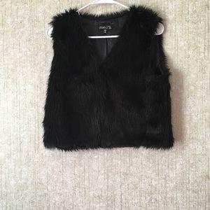 A black fur vest